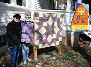 High Country Artists president Gerald Kauzlarch and vice president Kathy Webber with teh barn quilt hung for display on Saturday March 23, at Cle Elum's Carpenter House Museum and Art Gallery. See full story printed in this week's NKC Tribune.
