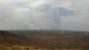 Smoke Plume Dominates Skyline Above Wind Mills Credit: Washington Interagency Incident Management Team #4